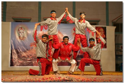 Students of the boarding school in Maninagar, who originate from Botad, perform a devotional dance