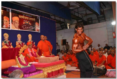 A student of Shree Swaminarayan Arts College who has won many body building competitions, demonstrates his skill