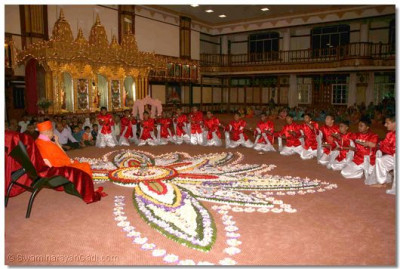 As part of their welcoming dance, the young disciples perform aarti