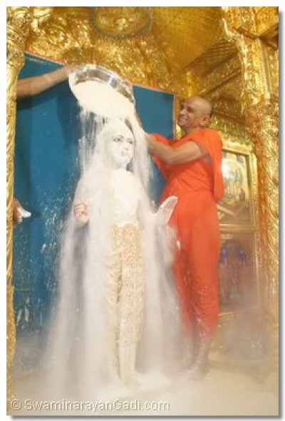 Lord Swaminarayan is bathed with sugar