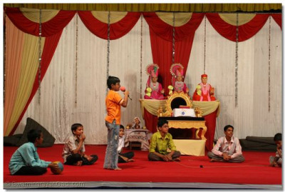 Young children perform devotional songs
