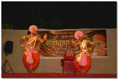 Sants dance to a kirtan during the evening performances
