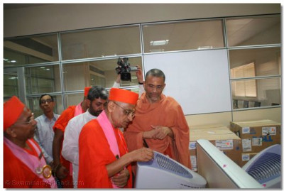 Acharya Swamishree performs the inauguration of a new computer suite