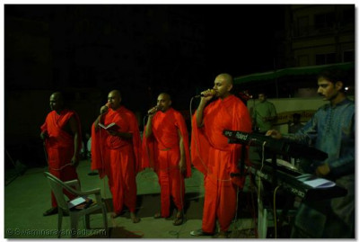 Swamibapa's talented sants sing devotional songs whilst the disciples dance