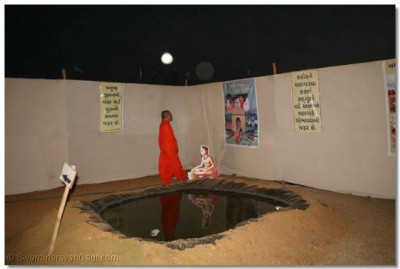 Acharya Swamishree views an exhibit