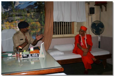 Acharya Swamishree gives darshan in the office of Shree S. P. Jadeja, the chief police officer, in charge of the jail