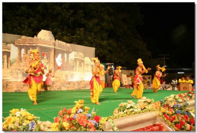 Students of Varodara perform a devotional dance
