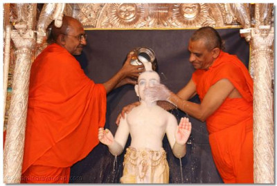 Lord Swaminarayan being bathed in milk