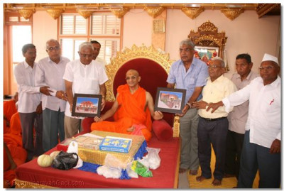 Acharya Swamishree is presented with an artists impression of the new temple in Vrushpur