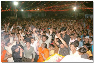 The youngsters in the audience dance to the devotional singing