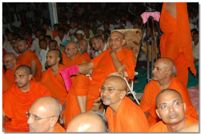 Acharya Swamishree and sants watch the devotional dance performances