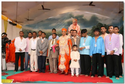 His Divine Holiness Acharya Swamishree and the disciples on whose behalf the scripture recitals are being held