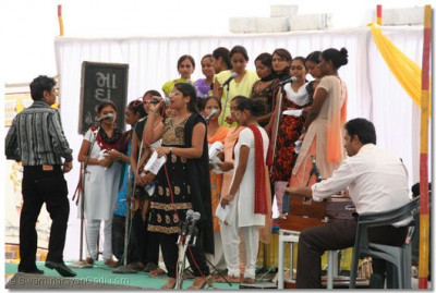 Students of the college sing kirtans