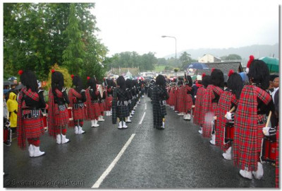 The pipe bands lead the procession towards Bowness Pier