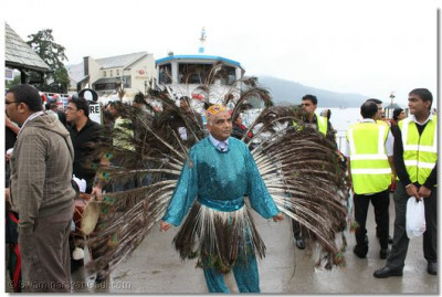Disciple performs a peacock dance during the procession