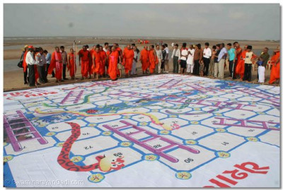 A giant game of snakes and ladders, based on religious questions