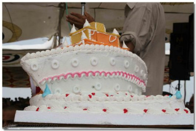 A special celebration cake, shaped like a ship, had been made for the occasion