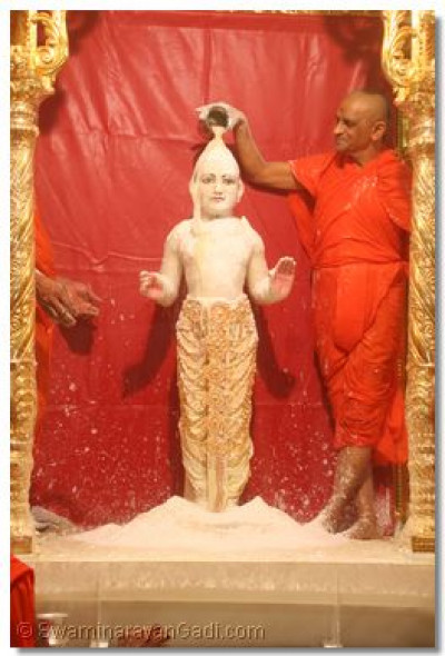 Lord Swaminarayan being bathed in Ghee