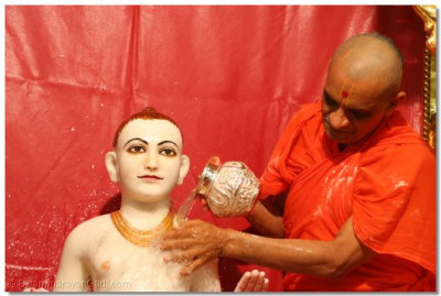 Lord Swamishree is bathed with water