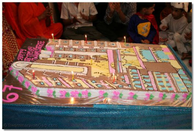 The cake was shaped like the new Mumbai Mandir when all the vast extension work is completed