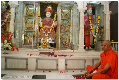 Rose petals are placed at the Lord's lotus ffet as the sacred name of God is recited 108 times
