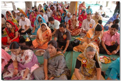 Disciples take part in the Yagna Ceremony