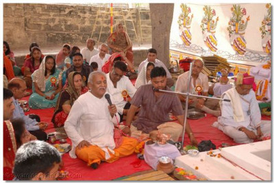 The Brahmins recite the sacred verses and lead the Yagna Ceremony