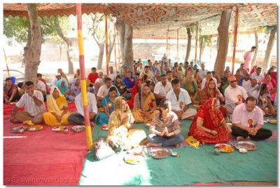Disciples take part in the Havan Ceremony