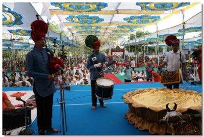 Disciples from Bolton, UK perform on stage with the pipes, drums and dhol