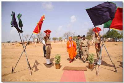 After greeting Acharya Swamishree on His arrival the camp commander escorts Him to the reception area