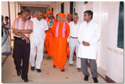 Achaya Swamishree is given a  tour of the new hospital