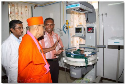 Achaya Swamishree gives darshan to a newly born baby requiring intensive care