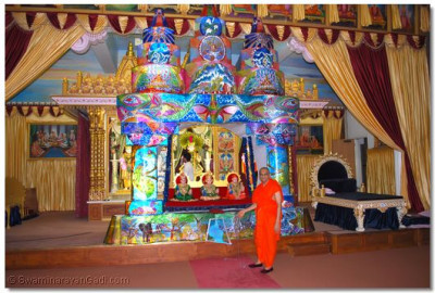 Acharya Swamishree gives darshan with Lord Swaminarayanbapa Swamibapa on a decoratives lights hindola