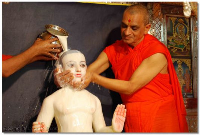 Lord Swaminarayan is bathed with milk