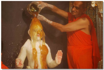 Lord Swaminarayan is bathed with honey