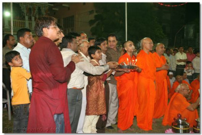 Sants and disciples who sponsors the event perform aarti