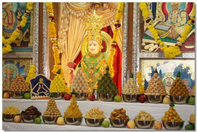 Lord Shree Swaminarayan dines on many varieties of sweet and savoury dishes