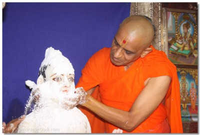 Lord Swaminarayan being bathed in sugar