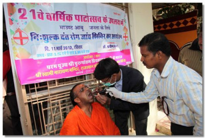 A sant is being checked by dentists