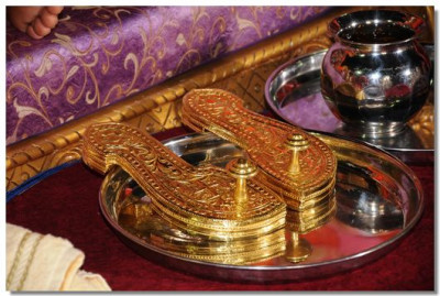 The divine golden paduka