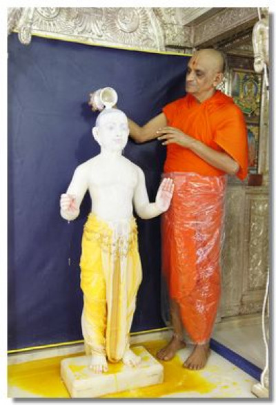 Lord Swaminarayan being bathed with milk