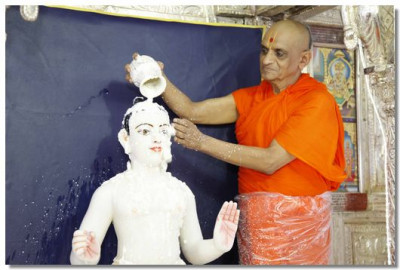 Lord Swaminarayan is bathed in yogurt