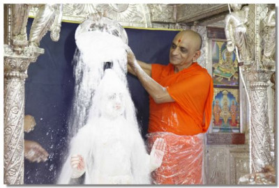 Lord Swaminarayan is showered in sugar