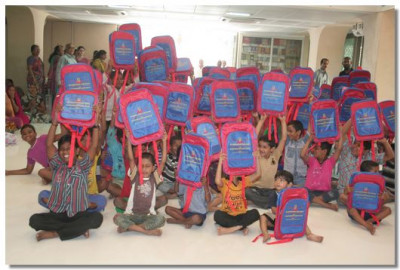 Children rejoice with their bags