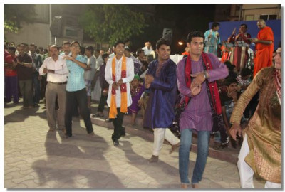 Disciples take part in the raas