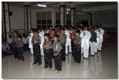 Young disciples of Surat perform a devotional dance