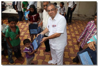 Children of Veer Bhagat Singh Primary School are given school bags