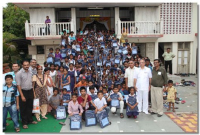Children of Veer Bhagat Singh Primary School with their school bags