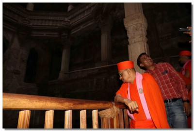 Acharya Swamishree looks down the stepwell