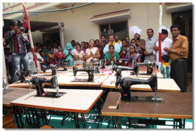 Ladies of Boridra receive their new sewing machines